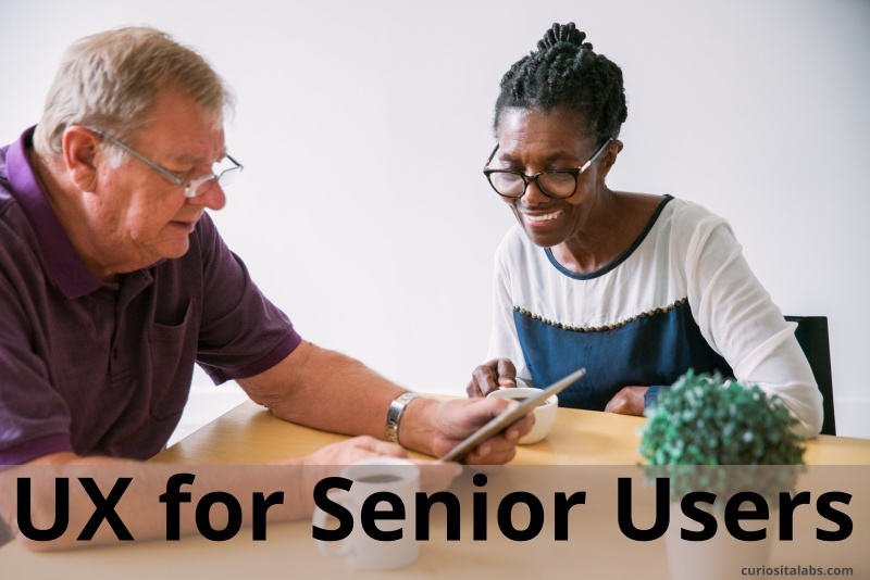 Two seniors using a tablet
